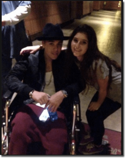 Justin Bieber playing poker in a wheelchair